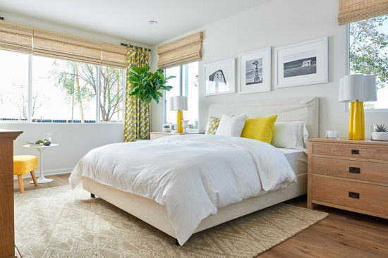 Swapping to lighter and brighter linens can help make your space feel more summery, so when you're shopping for warm weather linens, think about style as well as material (by William Lyon Homes)