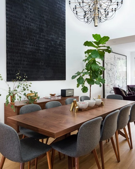 Upholstering mid-century modern chairs can help give them a more inviting, transitional look and feel (by You & Yours Interiors)
