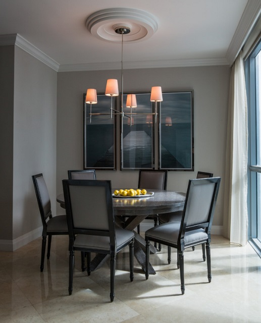 A round dining table can easily - and comfortably - fit at least one or two more chairs than you could on a square table of the same size (by Fein Zalkin Interiors)