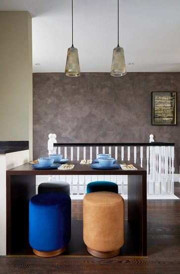 Backless dining chairs aren't necessarily the most comfortable, but they can be a lifesaver in open dining areas where you don't want bulky chairs blocking your walkway (by Kia Designs)