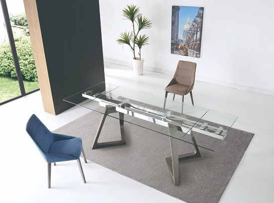 Extendable dining tables with built-in moving parts tend to be a little pricier, but can save you big time on storage space