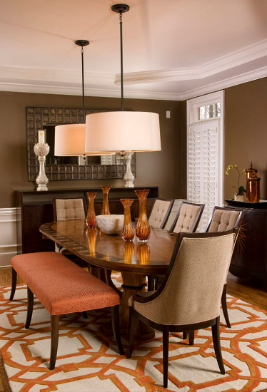 Trading out a few dining chairs for a bench is a great way to allow you to seat more people at the same table (by Susan Sutherlin Designs)