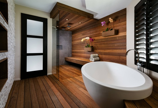 Cedar saunas have long been a trademark of nordic bathroom design, but tropical hardwoods like teak and ipe can stand up to use as steam showers as well (by Willoughby Construction)