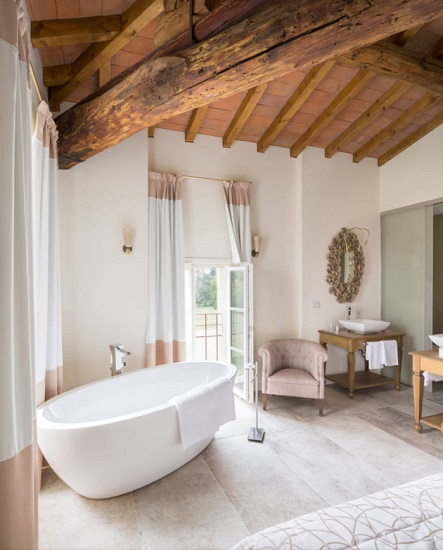 If you don't feel confident in your ability to keep natural hardwood happy and healthy in your bathroom, start with safer surfaces like your walls, ceiling, beams, doors, and accent furniture (Photo by Michele Gusmeri)