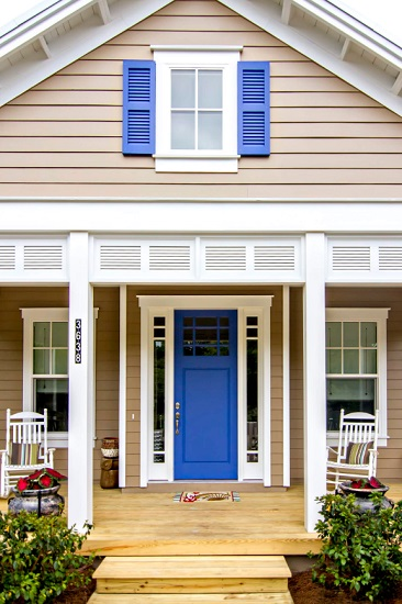 A bright blue front door can make your home feel instantly energized and inviting, and it's a project you can easily pull off yourself (by Glenn Layton Homes)