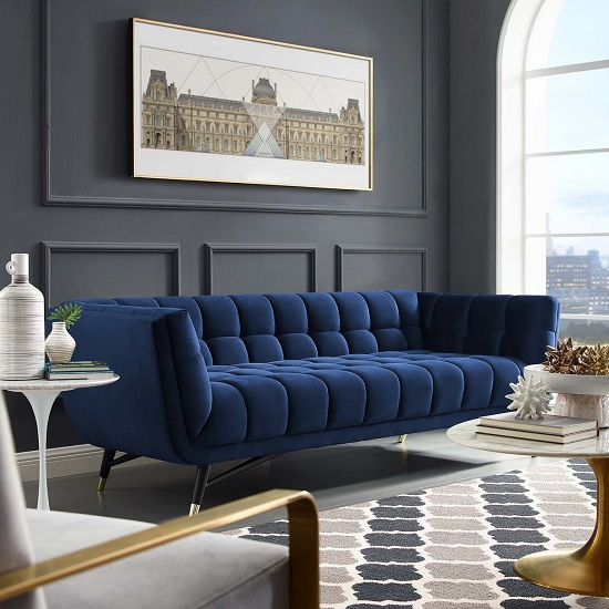 A single piece of Classic Blue furniture can add a bold statement to any room, and luxurious blue sofas are a popular way to do it (ft Adept Sofa)