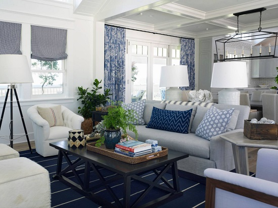 Changing out only a room's linens - throw pillows, area rugs, and curtains - can have a big impact when you opt for a bold color like Classic Blue (by Flagg Coastal Homes)