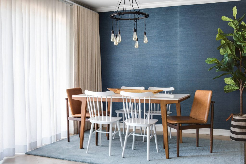 Denim-colored wallpaper is a particularly popular iteration of Classic Blue for use on the walls (by Chelsea Lauren Interiors)