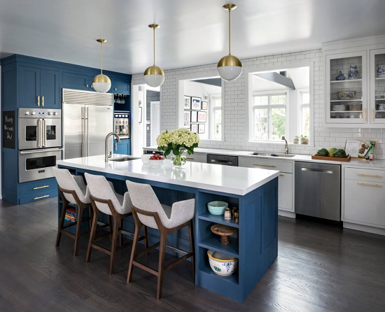 Even before Pantone announced their color of the year for 2020, Classic Blue was a popular choice for adding color to a white kitchen (by Studio Dearborn)