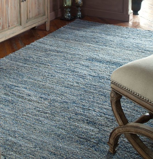 Adding a little touch of gray to a classic blue gives you something very denim-like...and a color that's much more netural feeling (from Uttermost)
