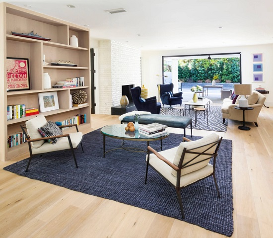 Denim blue area rugs are perfect for an open greatroom, helping create boundaries between different areas without closing off the space (by Von Fitz Design)