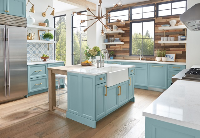 Bold colors, light wood, and warm metals are skyrocketing in popularity as alternatives to (or ways to dress up) a classic white kitchen (by Wellborn Cabinet, Inc.)