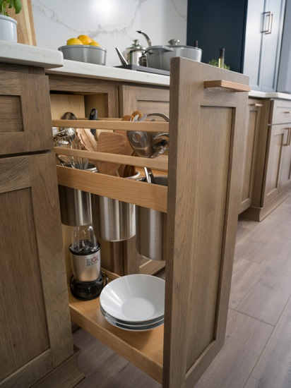 """""""A place for everything, and everything in its place"""" is the biggest theme for kitchen cabinets in 2020, from large dedicated pantries to highly-specialized, full-extension cabinets that help you maximize your space (by Dura Supreme Cabinetry)"""