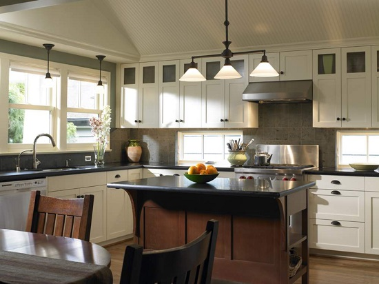 If you still love (and want to keep) your white cabinets, don't worry too much that they'll look dated - just focus on adding color and warmth when updating the rest of your space (by Goforth Gill Architects)