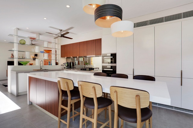 Open floorplans aren't going away, but they are getting a little less open - particularly where they can give your kitchen a little more privacy and a little extra storage space (by Dan Kitchens Australia)