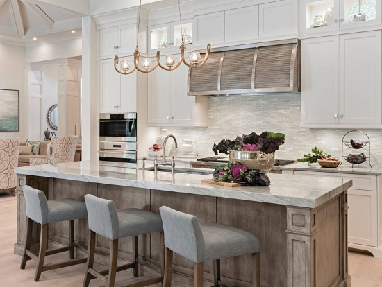 Swapping out boring bar-style pendants for unique, distinctive lighting fixtures is a great way to add personality and flair to your kitchen (from Home&Design)