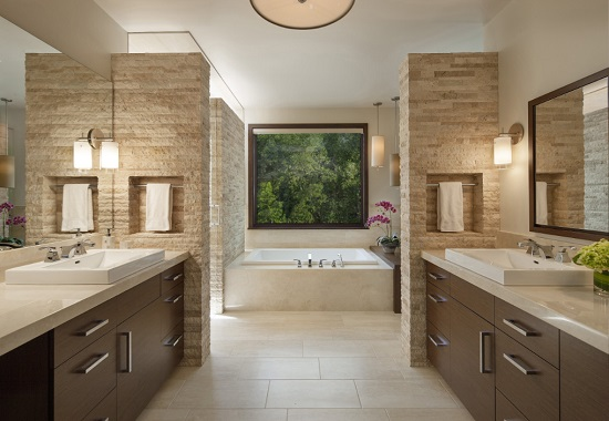 Travertine tile adds a touch of warmth to any bathroom, and natural slab stone provides a beautiful textural element as well (by Mosaic Architects Boulder)