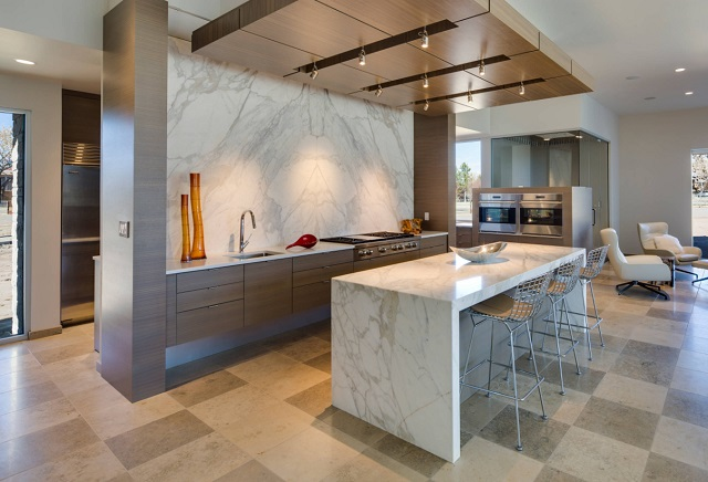Bold, distinctive calacatta marble has supplanted more subdued carrara in popularity, and is a particularly popular choice for large surfaces, like seamless backsplashes and accent islands (by Rocky Mountain Stone Co.)
