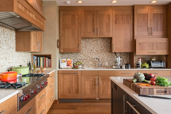 According to one school of thought, appliances large and small should blend seamlessly into the rest of your cabinetry (by Wagner Cabinetry and Design)