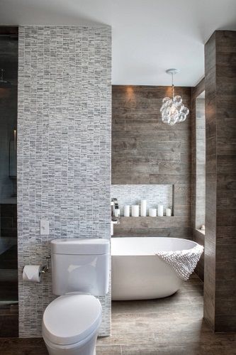 In contrast to big showers that are going for maximum exposure, bathtubs are getting a little more private, with garden tubs evolving into tub nooks or niches (by LBD, LLC)