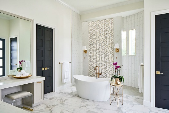 White marble with really bold veining can be enough to break up a white bathroom, especially when done on a large scale, or paired with some of these other tile trends (by Haven Design and Construction)