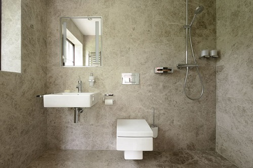 """Wet bathrooms are traditionally on the small side, but really the only difference between an """"open"""" bathroom and a """"wet"""" one is how waterproof the fixtures outside your shower are (by Floors of Stone)"""