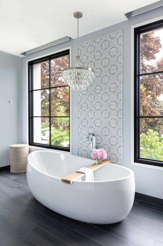 Backing or surrounding a statement bathtub with a unique and stylish tile is another great way to help it stand out (by Northworks Architects + Planners)