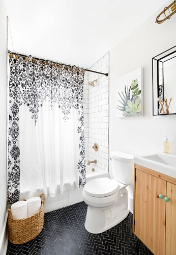 Other projects - like replacing your tile, lighting fixtures, or even linens and accessories - can supplement a wood bathroom vanity, but a good vanity can reframe a white bathroom all on its own (by Delphinium Design)