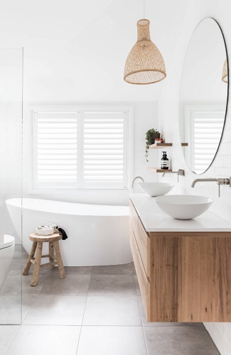 Replacing a white vanity with one made of wood is a simple and relatively quick and affordable way to give a white bathroom a major overhaul (by Bone Made)