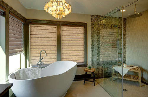 Statement bathtubs should be showy in apperance, but they also need to be placed prominently in your bathroom for full effect (by Urban I.D. Interior Design)