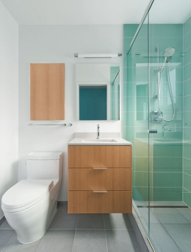 Supplementing your vanity with matching storage is a great way to add more color to a white bathroom (by Suzy Baur Design)