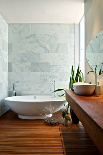 The best statement bathtubs are freestanding tubs that have a unique and distinctive shape - regardless of what material they're made of (photo by Andrew Snow)