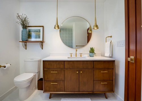 Very light natural-toned woods have long been used as a way to warm up a white bathroom, but don't be afraid to experiment with darker woods and finishes (by Custom Design & Construction)