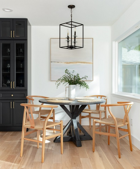 Choosing lean furniture that you can look through will help keep a tight dining area from feeling overcrowded (by Jessica Koltun)