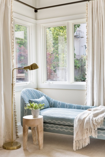 A sleek chaise by a sunny window is a simple reading nook setup that will please most book lovers - if you have a good spot and the space to spare (by Regan Baker Design Inc.)