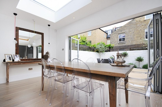 Even indoors, acrylic chairs can be a unique design choice, and can help keep the view through a room to an outdoor space relatively clear (by MDSX Contractors)