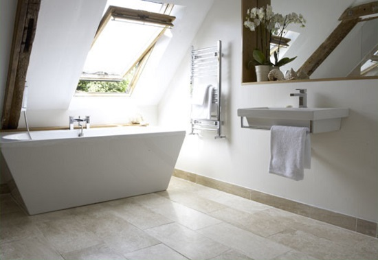This bathtub is inarguably going to be a little difficult to get in and out of, but the skylight saves it by making it actually a pretty lovely spot to soak (by Anne Webster Designs)