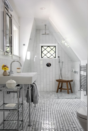 This super-unusual sloped ceiling might not seem like the ideal spot for a shower, but the high gable will let you stand tall while the outward slope will keep your arms and shoulders from feeling squished (by Giammarino and Dworkin)