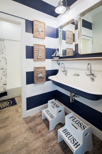 Color choice and accessories mark the biggest differences between aquatic, nautical, and seaside bathrooms - and are often distinct at a glance, despite their thematic similarities (by Michael Pagnotta Architects)