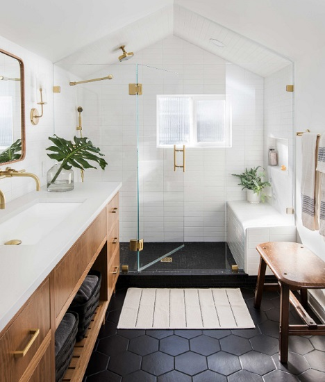 Adding a combination of warm, earthy elements and live or cut greenery is the best way to create a soothing natural ambiance in your bathroom (by Casework)