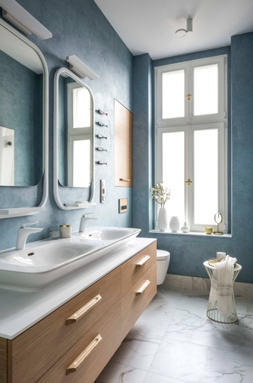Even very simple sanitary changes - like swapping to an easy-to-operate single handle lavatory faucet and wall-mount toilet flush valve - can make it easier to keep your hands clean (by Grant Studio)