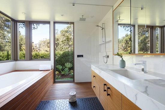 Shower enclosures have become practically invisible, creating wide-open and easily accessible spaces to unwind (by David Henig, Architect)
