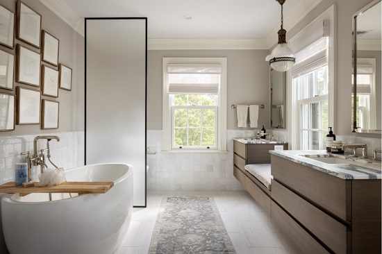 Simple, seamless, non-porous surfaces are easier to clean and keep clean - whether it's a composite countertop, large format porcelain tile, or a smooth acrylic bathtub (by Rosen Kelly Conway Architecture & Design)