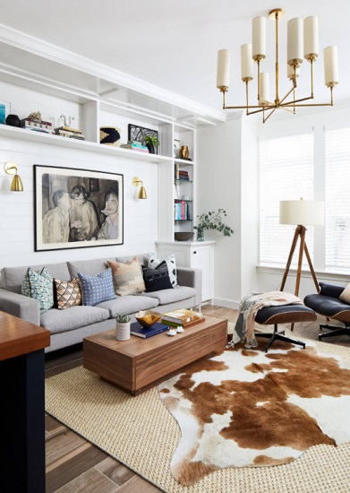 Building a living room around neutral base pieces is a great way to create a versatile space that will last you for years - but you can't forget to accessorize (by Danish Builders Inc.)