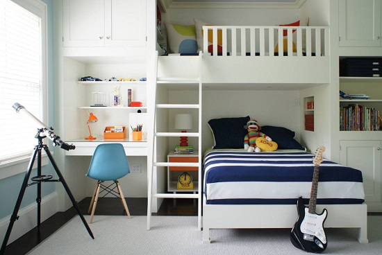 An image of a children's room with a built-in bunk bed and desk designed for two children of different ages sharing the same room
