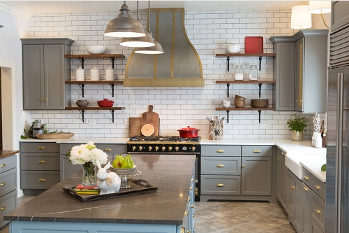 An image of a gray kitchen with industrial style wood and metal open shelves to either side of the range hood