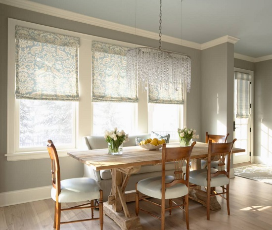 An image of a warm and bright breakfast table topped with a modern crystal chandelier