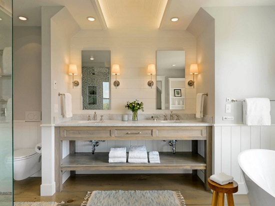An image of a French Country style double vanity with sconces bracketing the mirrors above both sinks