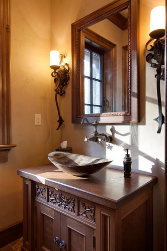 An image of a small, traditional guest bathroom with an oblog stone vessel sink
