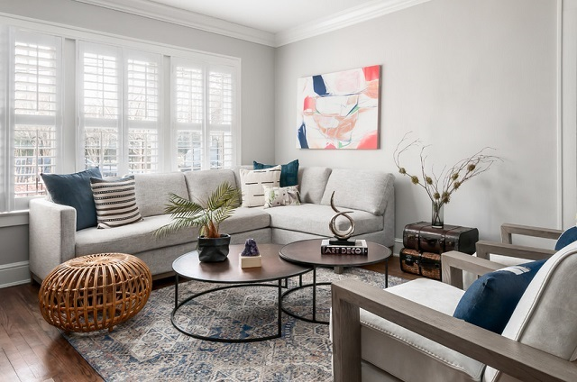 An image of a small contemporary living room, with a set of nesting coffee tables in the center of the room